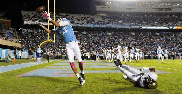 North carolinas mack hollins lifts ryan switzer following switzers touchdown against georgia tech during the first