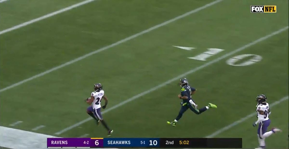 Marcus Peters houses interception in Ravens debut