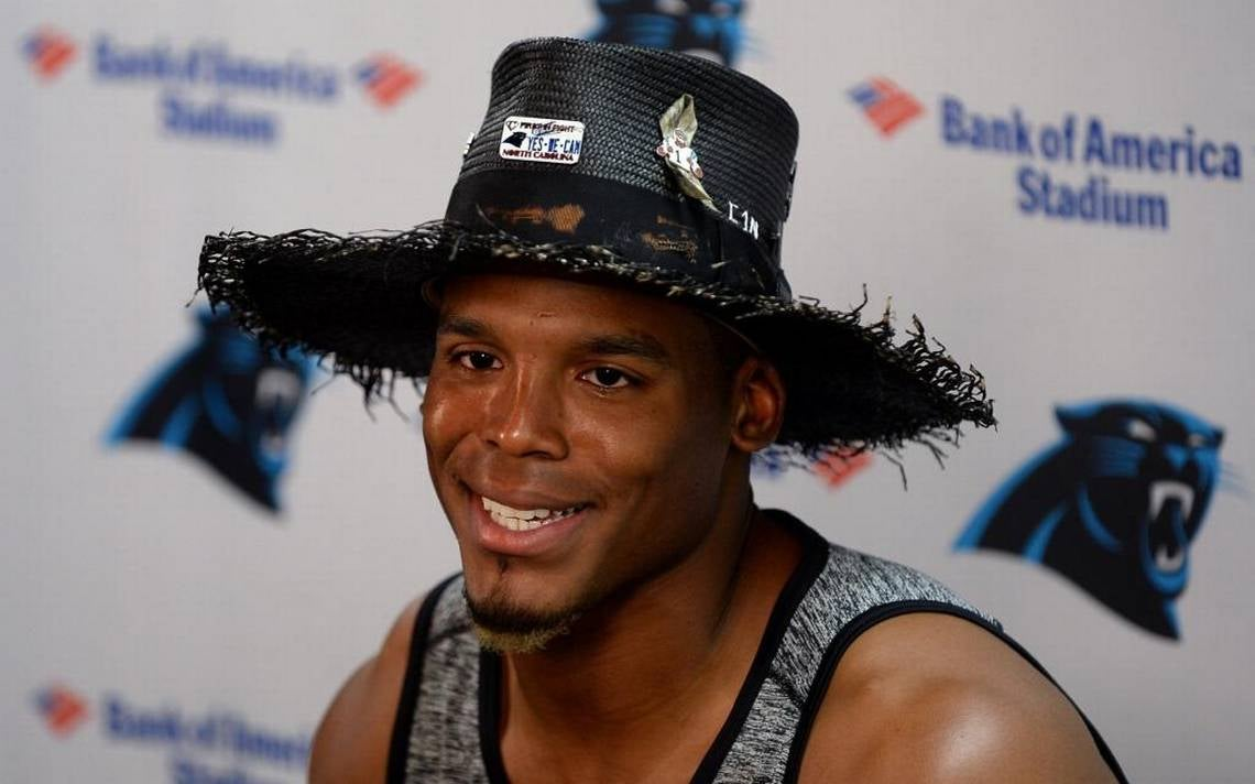 Newton Arrives To First Preseason Press Conference With