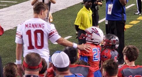 Eli Manning greets Jared Lorenzen's son during preseason game