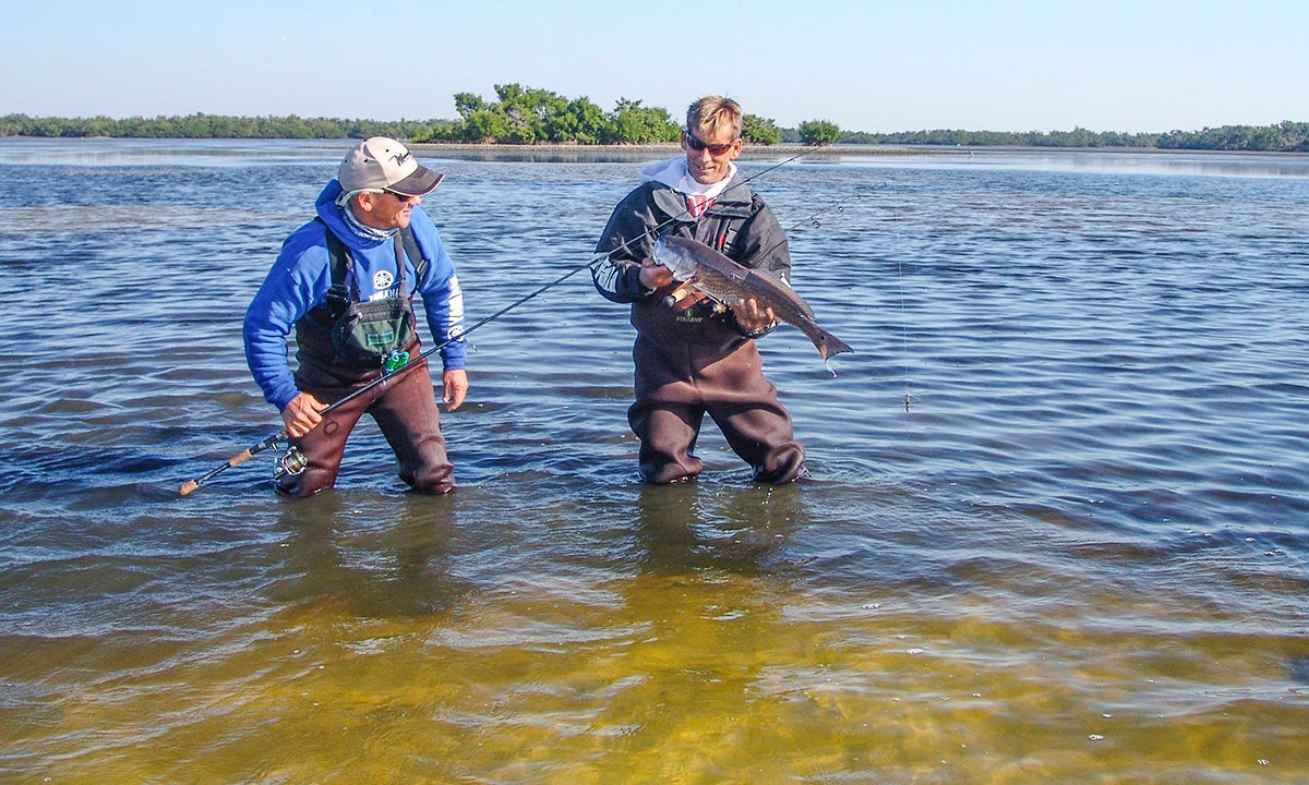 Why you should wade fish for redfish for Wade fishing gear