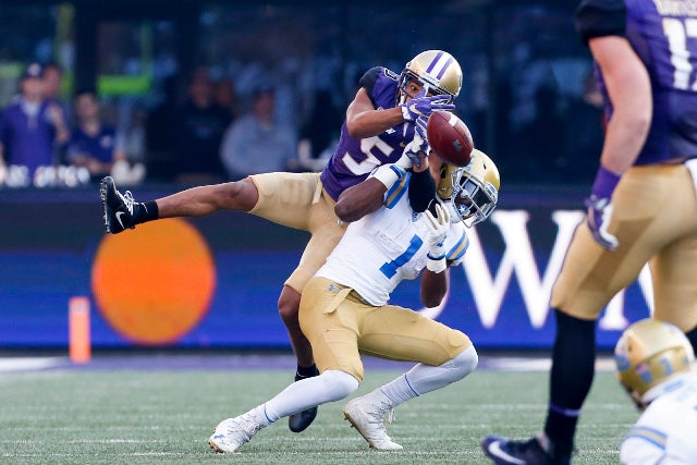 Washington Huskies (5) DB Myles Bryant and (14) DB JoJo McInTosh