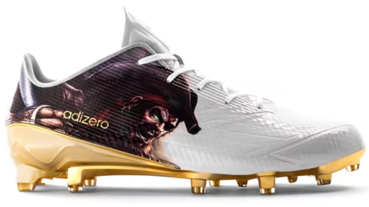 purple and gold adidas cleats