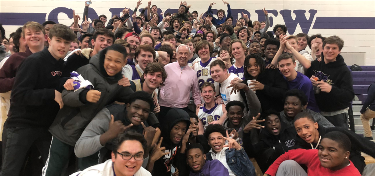 Roy Williams Watches Five-Star Caleb Love, Takes Big Group Photo