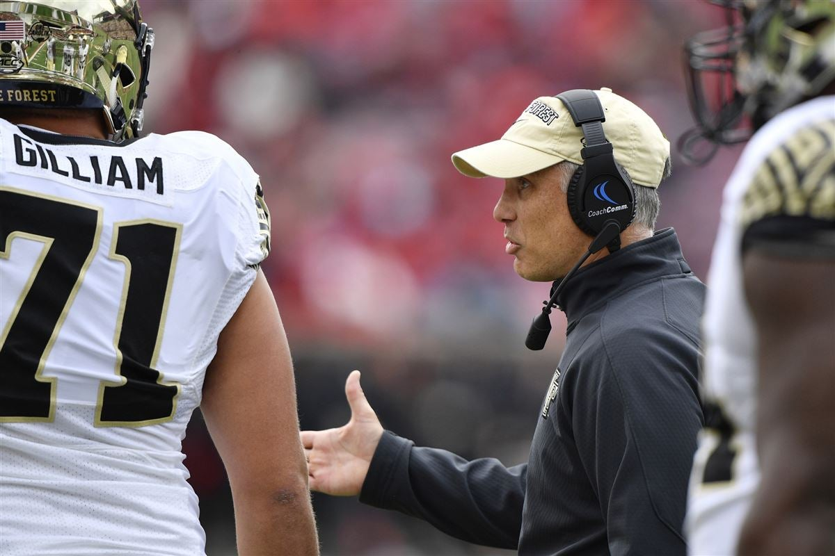 Wake Forest Demon Deacons Head Coach Dave Clawson Talks With Offensive Lineman Nathan Gilliam 71 On The Sideline During Second Half Against