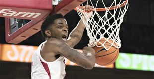 Hogs pull away from Roadrunners in second half