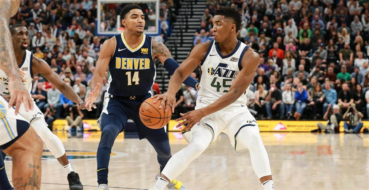Chris Mack congratulates ESPY winner Donovan Mitchell