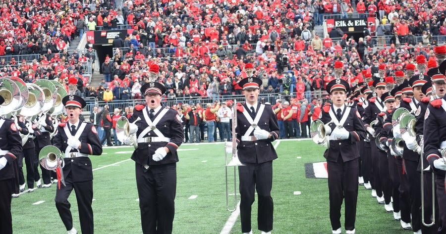 Buzz Aldrin applauds OSU marching band for moon-landing tribute