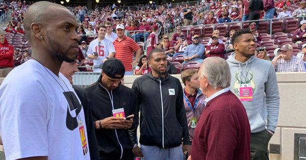 Khris Middleton, Giannis Antetokounmpo at A&M-Alabama game