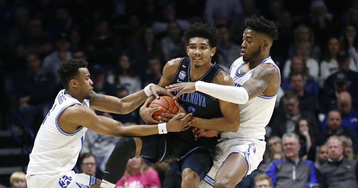 Cats muscle past Musketeers, 64-55