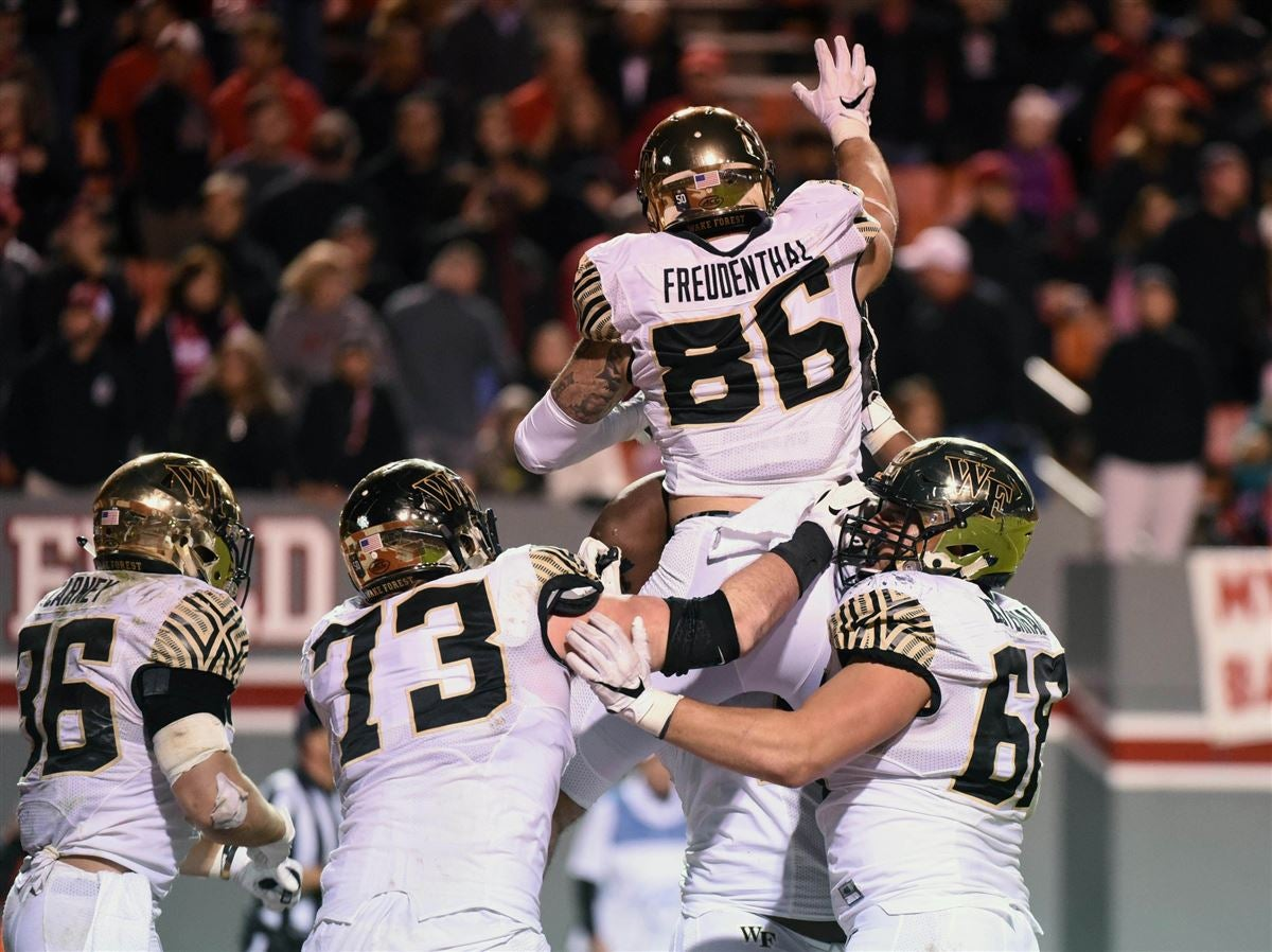 Wake Forest Demon Deacons End Jack Freudenthal 86 Is Greeted By Teammates After Scoring The Winning Touchdown During Second Half Against